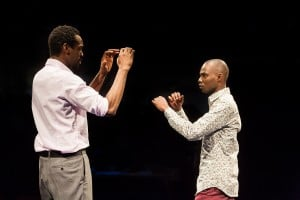 (l-r) Sule Rimi as Joe and Fiston Barek as Dembe in THE ROLLING STONE by Chris Urch (Royal Exchange Theatre until 1 May). Photo - Jonathan Keenan