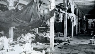 Inside the POW camp barracks%2c there were 8 people using each bunk at the time - small