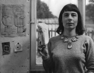 Mitzi Cunliffe with designs and a version of the BAFTA mask (credit: Estate of the artist).