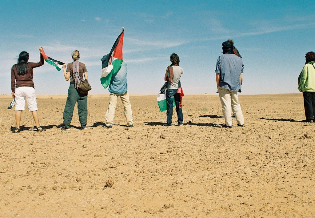 Sahrawi men facing the Berm. Credit: Michele Benericetti