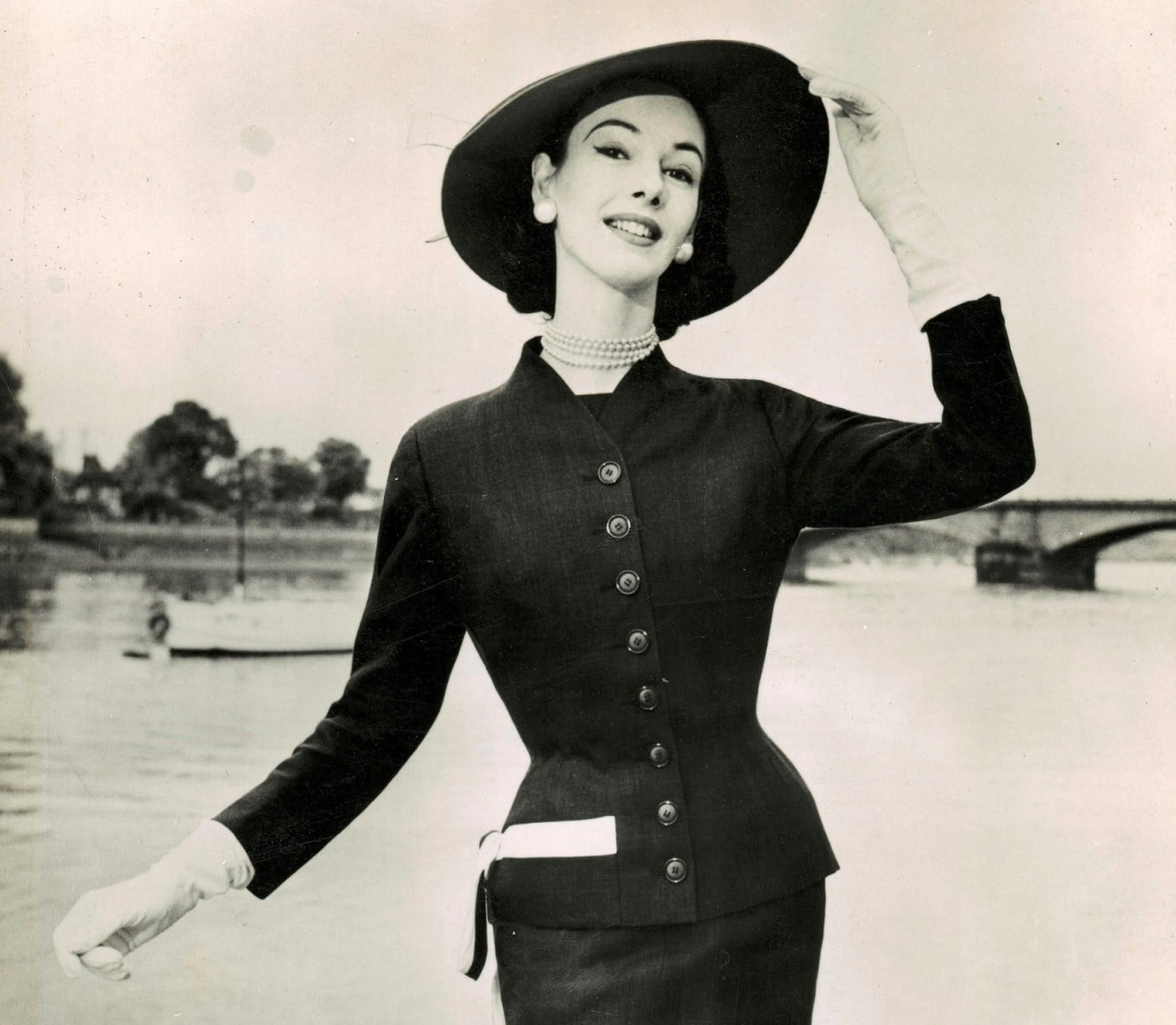 June modelling a tailored wool suit holding the brim of her picture hat about 1951-52 location and photographer unknown (2)