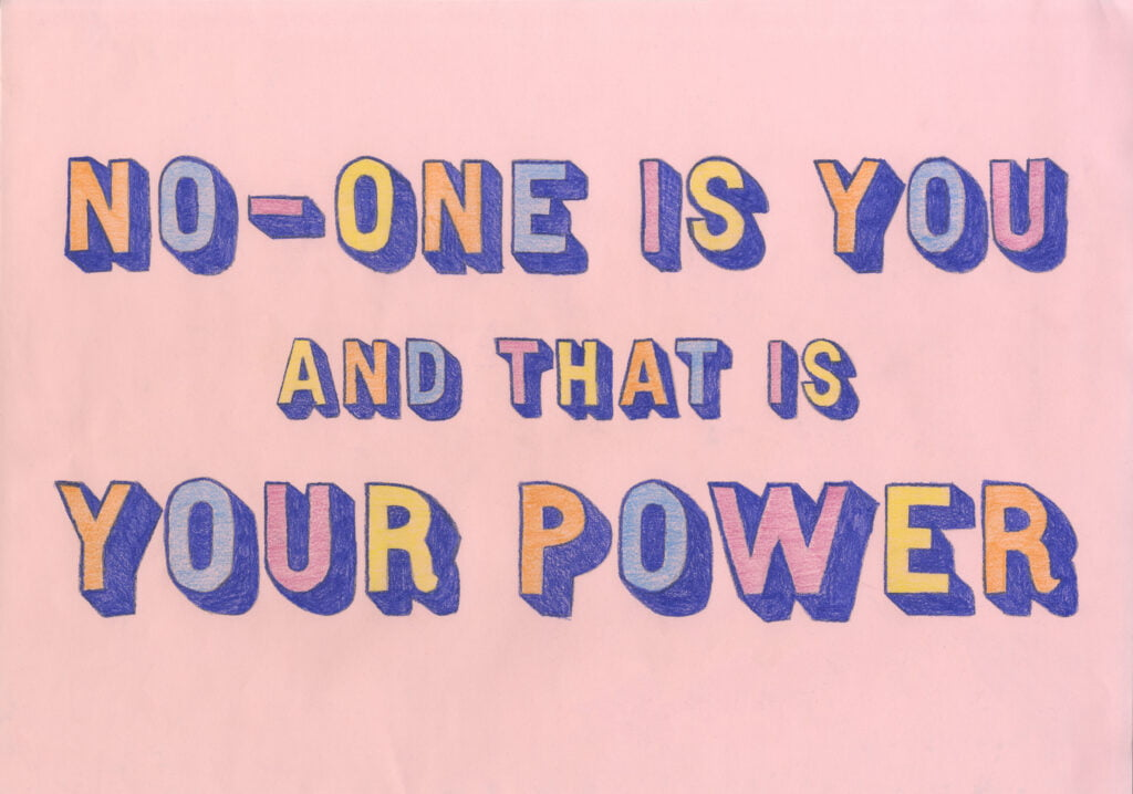 Pastel pink paper with hand-drawn lettering and coloured with pencil in this order: orange, light blue, light purple, yellow. They are shaded with dark blue. The letters read 'No-one is you and that is your power'.