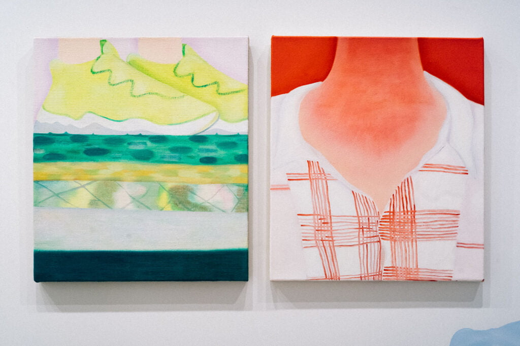Two paintings, one of yellow trainers with green elements standing on a green and yellow surface of different patterns and the other a painting of a neck and a checked shirt, in red tones, with the light skin of the neck looking sunburnt